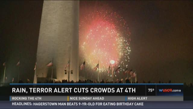 Rain, terror threats cuts crowd for mall fireworks