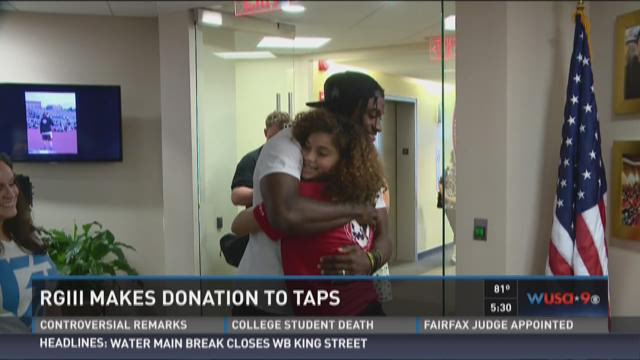 RGIII surprises a military family with a check from his non-profit, Family of 3.