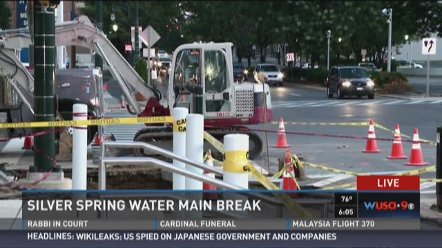 Crews work on the water main break in downtown Silver