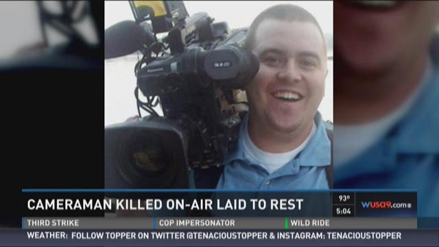 Cameraman killed on-air laid to rest