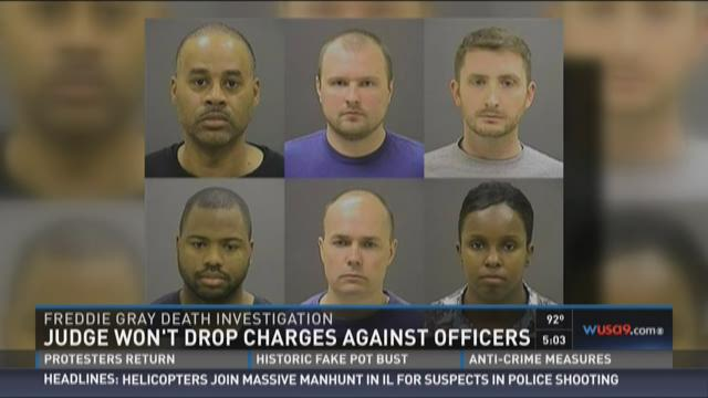 Judge won't drop charges against officers