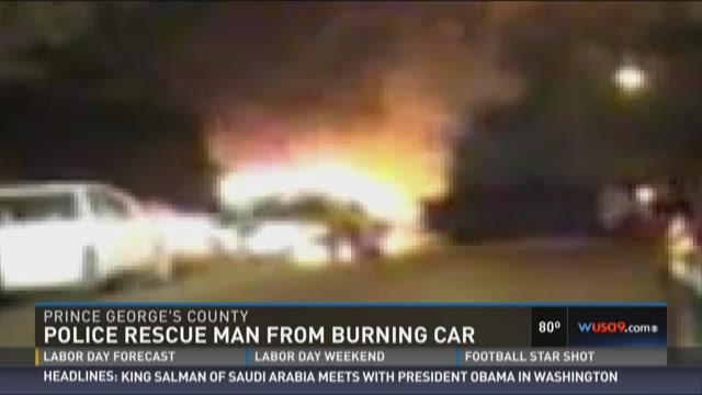 Police rescue man from burning car