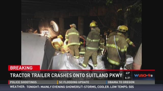 A tractor trailer fell from the Capital Beltway onto